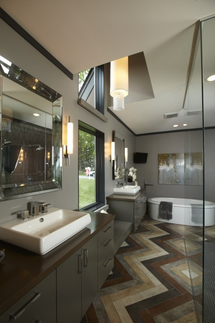 Fantastic multicolored floors in this contemporary bathroom. Follow CollegeGuyDesign if you like things like this showing up on your dash! interiorstyledesign:  Master bath with a clerestory window and unique herringbone floor (via Highmark Builders)