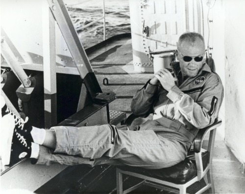Astronaut John Glenn just, you know, chillin' after his fire-engulfed capsule landed in the Atlantic Ocean on its way back from space.
