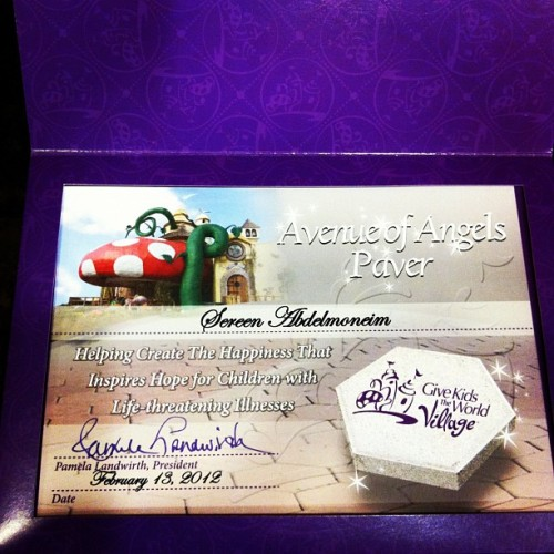 "Received our ""Avenue of Angels Paver"" certificate from @gktwvillage today (Taken with instagram)  The paving stone that will soon be a part of the Give Kids The World Village's walkway of love will be engraved with:  ""Sereen Abdelmoneim and Family Dec 2011"""