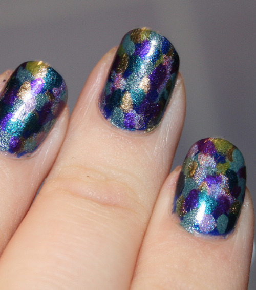makeupwhoreder:  Tried the 'mermaid scales' nail art tutorial I posted earlier.. but I did it sitting on my bed and I had no dotting tool.. it's messy, but I still like it.. very pretty and sparkly IRL =) Polishes used - butter LONDON - Dosh/Victoriana Chanel - Peridot China Glaze - IDK/Rodeo Fanatic a england - Avalon