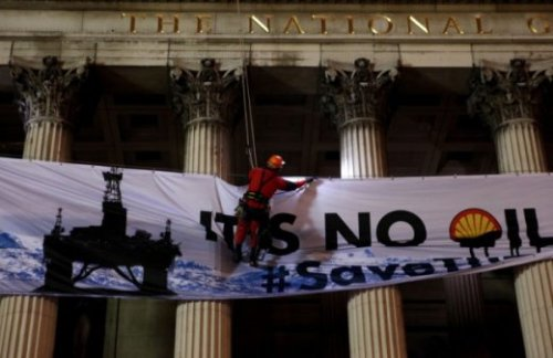 "anticapitalist:  Greenpeace activists today scaled the National Gallery in London to deliver a clear message from the rooftop: 'Shell Oil, Stay Out of the Arctic.' Greenpeace from the Rooftop: 'Do Not Drill in the Arctic'  Environmental campaigners climbed the roof of London's National Gallery to stage a protest against energy giant Shell. They scaled the gallery in Trafalgar Square, where an evening reception is being held for Shell, saying they wanted to demonstrate against plans to drill for oil in the Arctic this summer. The campaigners, from Greenpeace, dropped a 40-metre square banner, which has a picture of an oil rig and the words It's No Oil Painting, down the front of the gallery. One of the protesters, Hannah Davey, said: ""Shell is using the National Gallery to try and impress people they've invited along. But, at the same time, they're planning to drill for oil in the freezing Arctic, our planet's last wild ocean. ""The Arctic's coastlines are home to indigenous people, and its waters nurture polar bears, beluga whales and walruses. ""We're here to tell Shell, and their guests, that oil companies have to keep out of the Arctic. The region is too fragile to risk an oil spill that experts say would be almost impossible to clean up."""
