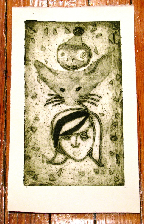 My second collograph print.  This is Elizabeth's totem.  The top animal is a turtle and the other animal is a large eared fox.  Still not finished with making as many as I'd like, but this one could very well be my BAT.  I used fabric, string, feathers, and paper to make the plate.