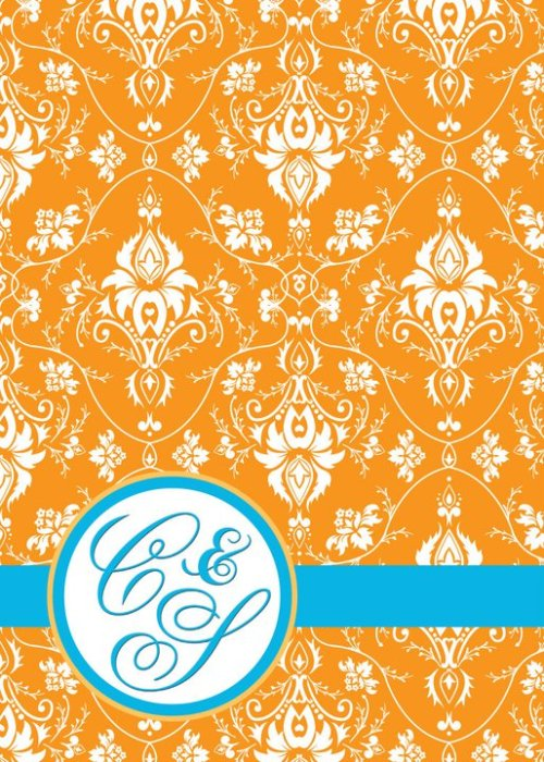 A custom damask pattern forms the backdrop for a personalized monogram look.