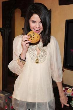 selena gomez eating a cookie