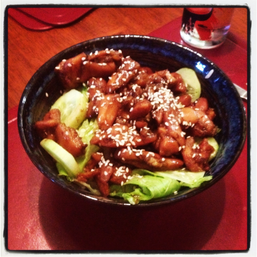 rumblingdaniel:  Chicken Teriyaki (by Nigella Lawson) Tried out this recipe the other day and it was a huge success. I have a fear of undercooking chicken, especially when covered in a dark marinade, so I might have left it on the stove for a little too long. With two fussy brothers who wouldn't eat the greens suggested in Nigella's original recipe, I had to make a few changes. Instead of bok choy I substituted shredded lettuce and cucumbers on top of a generous serve of sushi rice, which made for a refreshing summer dish. Broccolini might go nicely as well, cooked separately with some olive oil and pine nuts.  The sesame seeds were a personal addition more for presentation that flavour, but they do add a nice finishing touch.   Hey guys, I'm going to try and revive my food blog (rumblingdaniel) by posting pictures and commentary on the dishes I make. It's bound to stay very simple: iPhone shots in the moments before gluttony takes over and I devour the dish and notes about the difficulty of cooking (or eating) it.
