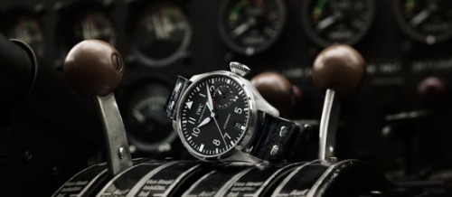"anchordivision:  IWC (International Watch Company), the illustrious Swiss watchmakers, was the first to develop a flight-ready watch in 1936 with the ""Special Pilot's Watch.""  One of the earliest models of this piece was the Big Pilot Watch, IWC's largest watch ever and a true testament to the size of Pilot Watches and the unprecedented amount of features packed into one timepiece.  Beginning with the face of the watch, the Pilot Watch's dial is reminiscent of the look of a cockpit with bold clear numbers and dashes for easy readability, a crucial attribute for pilot's who did not have time to waste trying to read a cluttered dial.  This face is protected by a dense, airtight piece of glass that is designed to shield the watch's movement from any debris that could potentially float in mid flight.  Below the dial is the movement itself, an unbelievably precise arrangement that is still to this day a marvel of modern watch manufacturing.  The movement is encased in a layered multi-component structure that protects it from any magnetic waves or atmospheric interference that might disrupt the watch's accuracy.  -via Wax Wane  This may be the watch I wear when I fly across the Atlantic in my single engine airplane. But first I need a pilots license. And an airplane…"