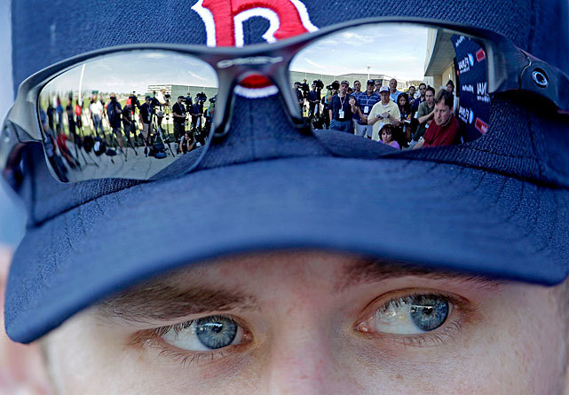 Members of the media are reflected in the sunglasses of Red Sox pitcher Daniel Bard as he speaks during a news conference on Tuesday. Bard is moving from the bullpen to the starting rotation this season. (AP Photo/David Goldman) LEMIRE: Valentine making big impression in first days with Red SoxDIVISION PREVIEWS: AL East | AL Central | AL West | NL East | NL Central | NL West