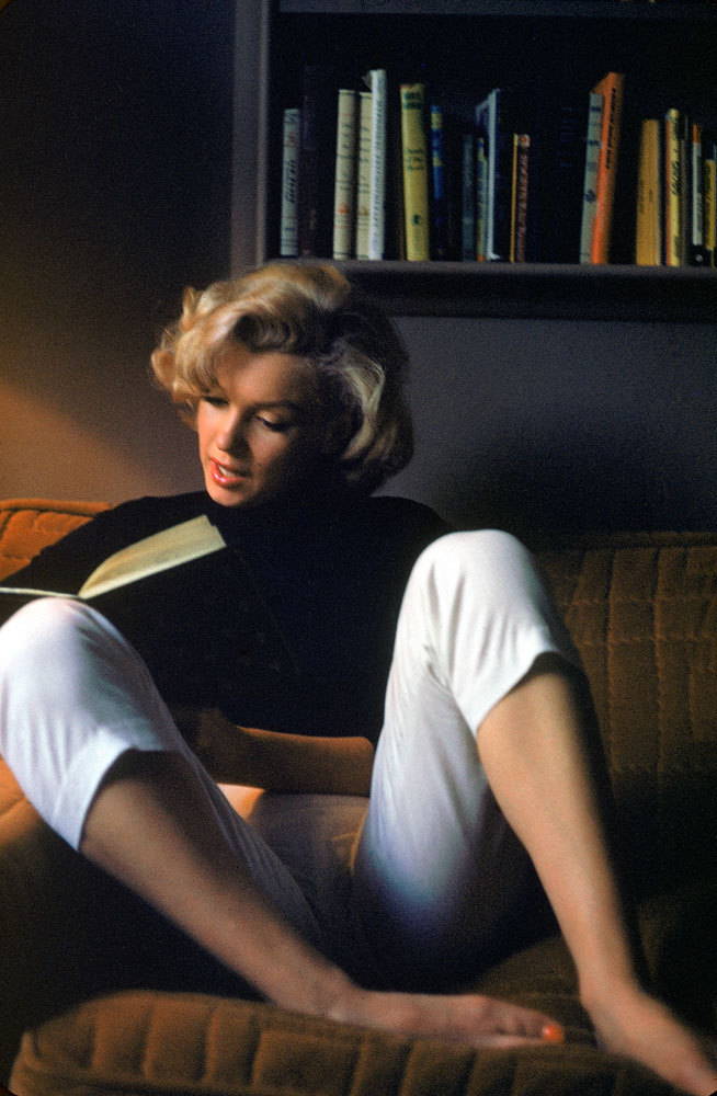 life:  Her sex-symbol image aside, Marilyn Monroe was an avid reader of 20th-century literature and was often photographed curling up with a book, as in this Peter Stackpole shot taken at her Hollywood home in 1953. (see more photos here)