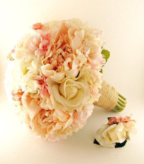 "Your custom package includes a bridal bouquet of ivory real touch roses,  pink latex peonies, white silk ranunculus, silk cherry blossoms and  blush pink real touch hydrangea.  The bouquet is banded in burlap  accented with pearl pins.  The bouquet measures 11"" in diameter and is  13"" long with a 6"" handle.  The bouquet is accompanied by a  groom's boutonniere of an ivory real touch rose accented with pink  hydrangea and cherry blossoms.  Its stem is wrapped in burlap and has  two pearl pins for pinning it on."