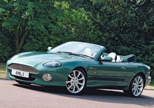 Chapter Two: The Meaning Behind Aston Martin's 'DB' Those who think of Aston Martin, associate the name with James Bond due to repeated movie appearances, but someone who should be more associated with Aston Martin is David Brown. While one could write an entire book on David Brown's life story and entrepreneurial achievements, let's focus on his days with Aston Martin. Most people buy a single car from the classifieds, but in 1947, shortly following WWII, Brown bought the entire Aston Martin company for a wopping £20,500 after finding it listed in the newspaper classified ads. Brown got down to business quickly. His passion for high performance sports cars and motor racing led him to develop the DB1 (2-Litre Sports) & DB2 which were great cars but came up short in race events. After taking what he learned from the DB1 & DB2, he developed the DB3S. It quickly showed its potential as a racer when it made its Le Mans debut in 1952 and from 1955-58, it won 3-consecutive Le Mans championships in its class.  But the most important DB cars were the DBR1 & DBR1S which won more than a half dozen world championships in the late 1950s, including a triumphant win by driver Stirling Moss at Le Mans in 1959. Following these cars, there have been a dozen other models that have sported the 'DB' nameplate, which had been forgotten in the 1970s but revived recently with the DB7, DB9, and DBS and every one of these cars are a little tribute to David Brown, the man who saved Aston Martin in the mid-20th century. All past 'The Art of Naming Cars' posts are compiled into a single page here. You can also read all previous chapters here. Photos courtesy of Aston Martin and other various sources.