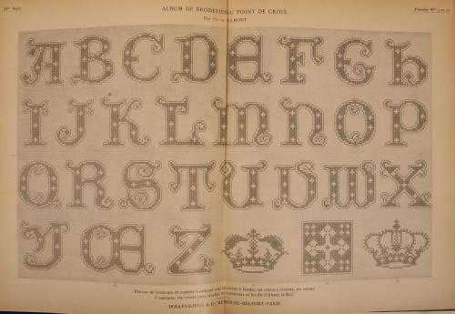 A wonderful double-page foldout cross-stitch alphabet from volume 2 of Dillmont's Album de broderies au point de croix.