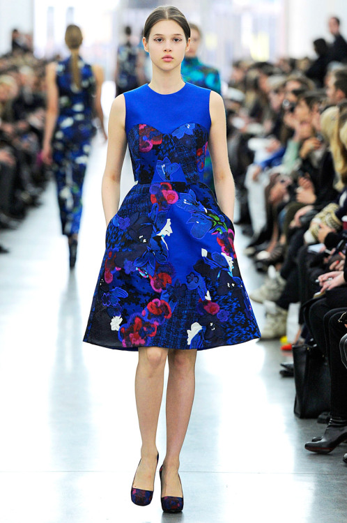 12minds:  vogue:  Erdem Fall 2012 Photo: Marcio Madeira/firstVIEWVisit Vogue.com for the full collection and review.  I like it when women wear dresses that have pockets. I find it weirdly quirky, distinctive, and happy. Also, loving both the bold blue and the print.  Drooling over here! I don't know how blue isn't every person's favorite color.