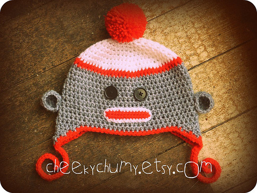 Sock monkey hat just like Misha's at http://cheekychumy.etsy.com