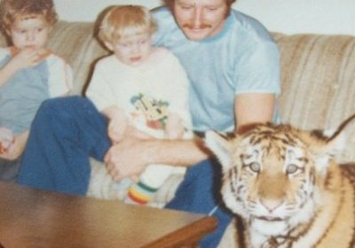 dadsaretheoriginalhipster:  Your dad was obsessed with cats before you were and he's owned a tiger named Whiskey to prove it. In accordance with the rules of manhood, he knew that true men only own majestic pets that have murder-thirst in their blood veins and a wild soul. He tamed the whiskered kill-beast into being the best home security system his neighborhood ever saw, and each night they shared a rare steak in celebration of their mutual badassery.  So hipsters, next time you're tumblr-deep in cat meme bullshit while petting your purring little ball of apathetic fluff, remember this… You really do take after your dad because you both own pets that are the personification of who you are. Unfortunately for you, you're a pussy.  Thanks to Ryan for the photo.