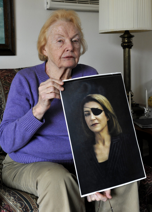 washingtonpoststyle:  Today, in two images. Rosemarie Colvin holds a photo of her daughter Marie Colvin, a journalist who was killed today while reporting in Syria. Photo by Kathy Kmonicek (AP) | 2007 portrait by Bryan Adams