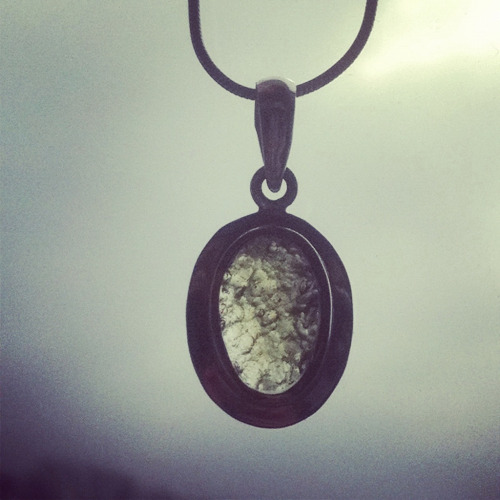 "darkmoontarot:  THE MAGICKAL & HEALING PROPERTIES OF MOLDAVITE Moldavite is a favorite stone of mine because of it's intense, ""out of this world"" energy! Moldavite is a tektite which means it was created from impact when a meteor struck Earth. The heat of the meteor impact melted surrounding rocks, dirt and sand creating a ""strew field"" of moldavite tektites that extends for miles. Moldavite is only found in parts of the Czech Republic, Germany and Moldavia making it a rare stone that will eventually become extinct. Tektites such as moldavite and libyan desert glass are NOT meteorites! You will frequently see them mislabeled as such in stores. Upon holding moldavite, many people will report feeling an intense surge of energy! You can often feel tingling sensations or a subtle vibration in your hand when holding a moldavite. It's common to feel fluttering in the chest, to have a hot flash, feel nausea, dizziness or to feel ""spaced-out"" when first holding/wearing a moldavite. These effects can last anywhere from minutes to days and it's just your body adjusting to moldavite's frequency. I suggest after you buy a piece of moldavite, you spend some time with it to see how it's energy effects you. It will often take time for your body to become acclimated to the intense energy of a tektite. Most people become acclimated to moldavite (and no longer experience the weird effects) within 3-5 days. Magickal Uses: Moldavite is an excellent stone to use to assist in astral travel and in the communication with spirit guides. Moldavite also assists in past life regression and it can help you to see into the future. Intuitive abilities often become stronger when wearing/carrying moldavite so it's an excellent stone to work with if you are looking to develop your psychic abilities. Moldavite and other tektites are not psychically protective. Moldavite can actually amplify your energy/feelings and the energy/feelings of those around you. Again, it's very important to see how moldavite effects you before you wear or carry it on a daily basis. It's often best to carry or wear black tourmaline, jet or smoky quartz with moldavite to help stay grounded & psychically protected until you are acclimated to moldavite's intense energy. Use caution when incorporating moldavite in magickal workings because it will assist in manifesting your intent/thoughts very quickly. Make sure your mind is clear and your intent is focused during magickal workings to avoid any problems when you work with moldavite. Healing Properties The fluttering most people feel in their chest while holding moldavite happens because moldavite helps to stimulate and open the heart & thymus (spiritual heart) chakras. When kept close to the body, moldavite will also begin to remove energy blockages in all of the chakras. If you have had trouble opening your heart chakra and releasing bottled-up emotions, moldavite is the stone for you! Moldavite also helps you to develop unconditional love for yourself and others. Because moldavite can amplify thoughts and make emotions more intense, it's best to use moldavite for healing purposes only when you are already healthy and fairly balanced. Moldavite is more a stone of activation and transformation than of healing. Moldavite also resonates well with the crown chakra and it helps to accelerate spiritual growth. While wearing or holding moldavite, solutions to problems will become clear. It's not uncommon to have an epiphany or two while working with moldavite! If you struggle with finding your purpose in this life, I recommend carrying or wearing a moldavite as it helps you to ""remember"" why you are here. Moldavite will often bring repressed emotions bubbling to the surface so that they can be either acknowledged, integrated or released. This helps to facilitate emotional healing and spiritual growth. Chakras: All  Zodiac: No specific associations  Planetary Associations: No specific associations  Color: Dark green, green, light green  Peace, Love & Magick Kelly The photo above was taken by Kris and the beautiful piece of faceted moldavite shown in the photo is from Kris' personal collection."