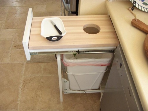 ultimatediy:  Make a cutting board slide out with your trash bin