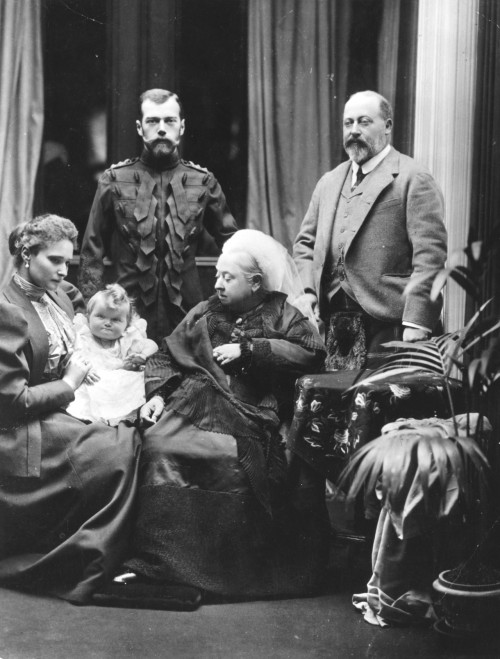 glukauf:  Victoria, Queen of Great Britain, at Balmoral Castle in Scotland, with her son Edward, Prince of Wales (right), and Tsar Nicholas II of Russia (left). Seated on the left is Alexandra, Tsarina of Russia, holding her baby daughter Grand Duchess Olga. UK, 1896. I was about to say how fabulous is Nicolas's outfit, but will you just look at Olga's face!