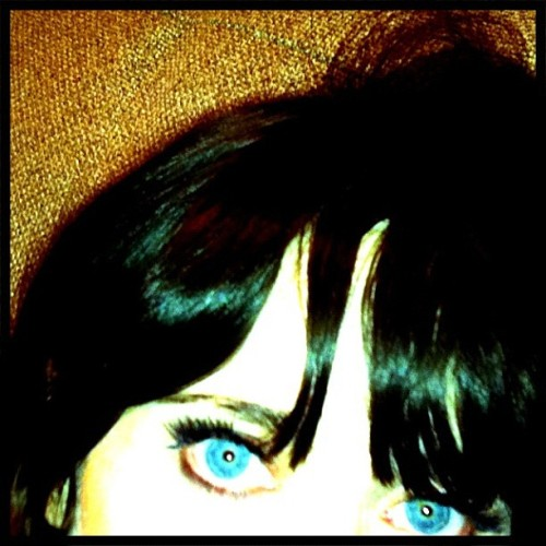 zooeydeschanel:  Bangs and eyes on wednesday night. (Taken with instagram)