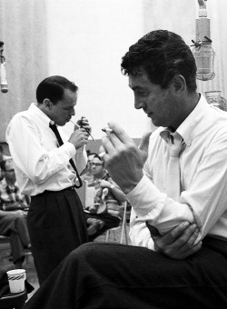 missavagardner:  Frank Sinatra & Dean Martin break on studio, photographed by Allan Grant, 1958.