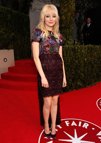 Emma Stone at the Oscar Vanity Fair party last year. Normally I really hate how interesting up-coming actresses start dressing really sophisticated and almost matronly in Chanel (and others) after some big break and lose all their individuality. But try as I might, there is nothing bad I can say about this particular outfit -  the miniskirt, the train, the fireworks, the different colours, I love it all.