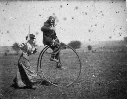 maudelynn:  Man on a penny-farthing bicycle being chased by his sister (Maggie & Bob Spiers) - West Wyalong, New South Wales, c. 1900 via brainpickings.org