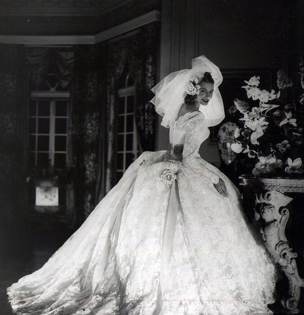 Gorgeous wedding gown, designer and photographer unknown, 1950s  Ok this is freaky. Last night I had the most vivid dream that I got married again. First pic I come across this morning whilst searching for stuff to bore you with is this! =:-O It's a sign…God help me :/