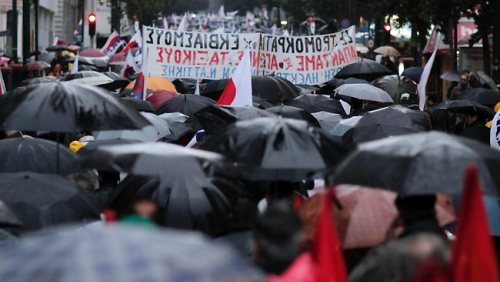 "around 5700 demonstrators marched in the rain after calls by leftist  unions and a communist group for protests against the bailout deal,  police said.  Thirty people were detained for questioning and two were arrested. Around 2000 people demonstrated in Greece's second city Thessaloniki, police said. The  two main unions, GSEE and Adedy, had called the protests over new  salary and pension cuts required under the latest bailout package. ""I  came to support our Greek friends but also to see what might happen in  Italy soon,"" said Bruno Matteo, a 25-year-old Italian joining his Greek  girlfriend at the protest. ""They just put money from one pocket  to another, back and forth, while no one thinks of people who need to  survive,"" Mr Matteo said."
