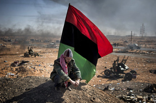 Titled Battle for Libya this image won the first prize for stories in the general news section of the 2011 World Press Photo awards. It shows rebel forces outside Ras Lanouf, Libya, March 2011 Photograph: Remi Ochlik/Bureau233/Eyevine French photographer Remi Ochlik was killed February 22, 2012 during the attacks on Homs in Syria. Click on the photograph for more information.