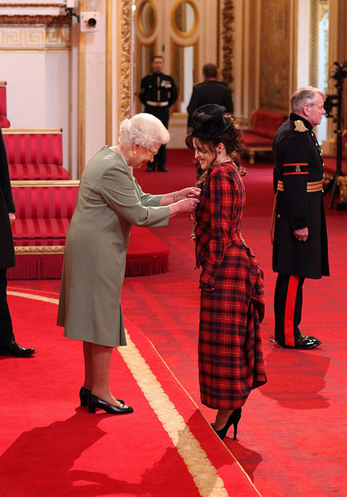 suicideblonde:  Helena Bonham Carter receiving Commander of the British Empire award for her services to Drama at Buckingham Palace, February 22nd  HBC being her awesome self, wearing Vivienne Westwood and a lil top hat and giggling while the Queen is pinning the medal on her.  GURL I LOVE YOU!  And, Your Majesty, this is for you:
