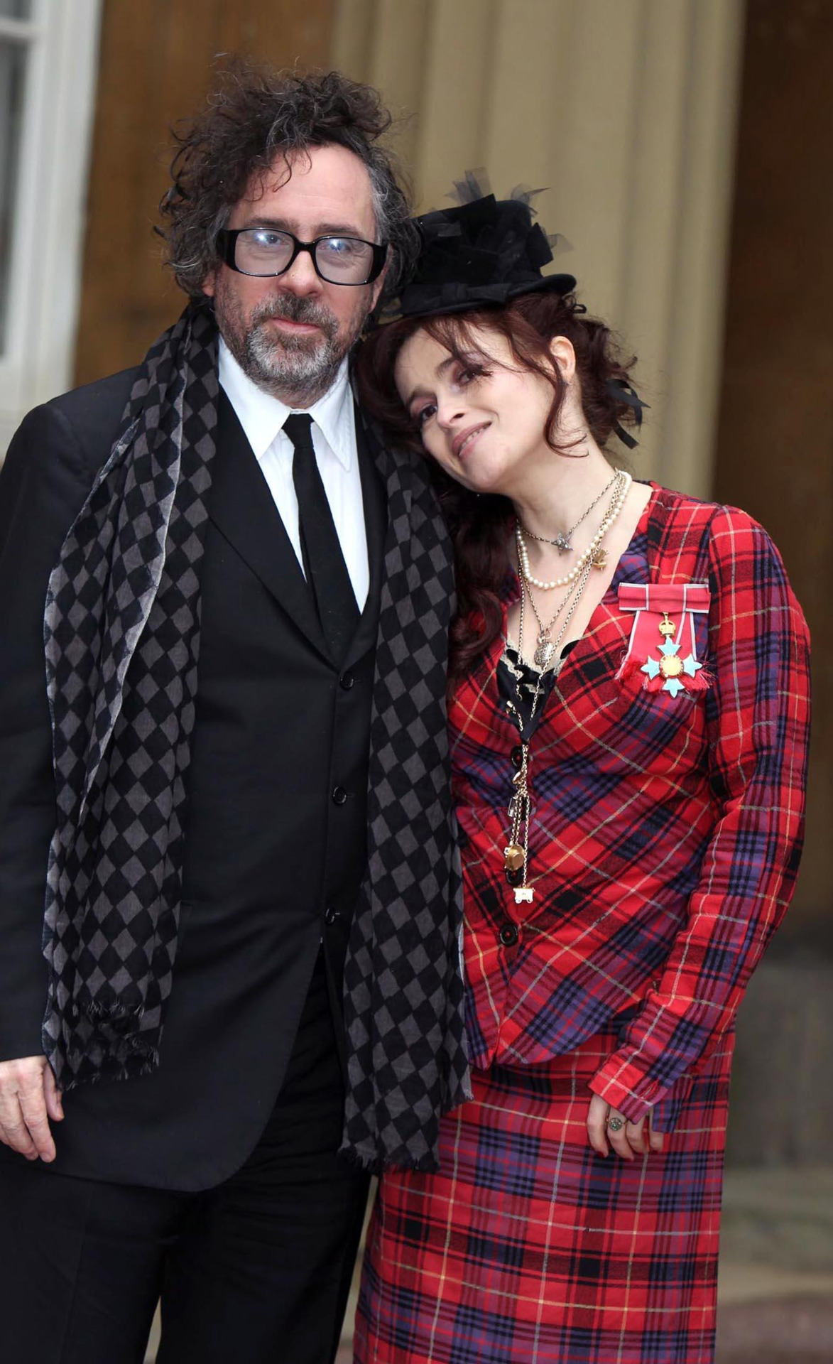 "suicideblonde:  Tim Burton and Helena Bonham Carter at Buckingham Palace, February 22nd Helena Bonham Carter received a Commander of the British Empire award for her services to Drama from the Queen. The actress believes that her father Raymond, who removed a tumour on his brain in 1979 via surgery and was left severely disabled until his death in 2004, would be incredibly proud.   ""I always thought my father deserved a medal for facing 25 years of chronic disability with quiet daily heroism so I am delighted to accept such a wonderful honour in his memory,"""