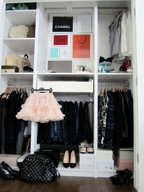 Cute Closet!  I love the framed shopping bags it makes the whole closet! My friend, a fashion blogger, also framed bags from her favorite stores and hung them on her bedroom wall. It's a chic and inexpensive way to create conversational artwork.