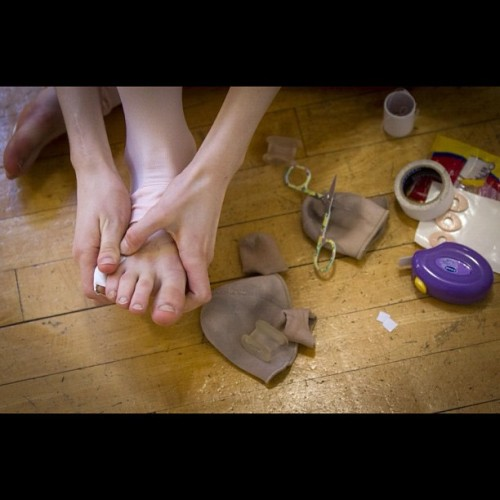 A young ballet student prepares her feet before dance lesson at the Goh Ballet in Vancouver February 22, 2012. (John Lehmann/The Globe and Mail) @johnlehmann #feet #ballet #dance #vancouver #photojournalism  (Taken with instagram)