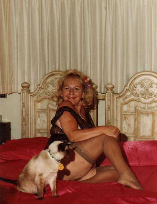 "February 1978: Lotte and ""my new Siamese kitten, Dornis the Great"" (according to the back of the photo). Lotte, PLEASE put some pants on, for the sake of kittens everywhere!"