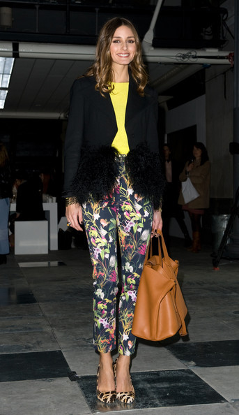 Olivia Palermo's take on smart spring dressing. Floral and brocade patterned pants and skirts are certainly a hot item for spring; as are bright, vibrant colors. Olivia keeps the look grounded with a black jacket and a caramel colored leather purse.