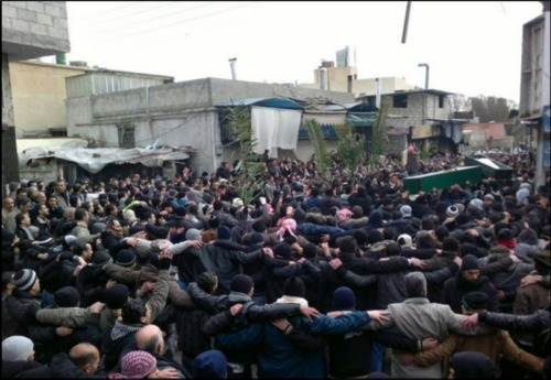 Anti-Assad mourners carry the coffins of two protesters during a demonstration in Damascus  I love this photo. These people deserve our support.