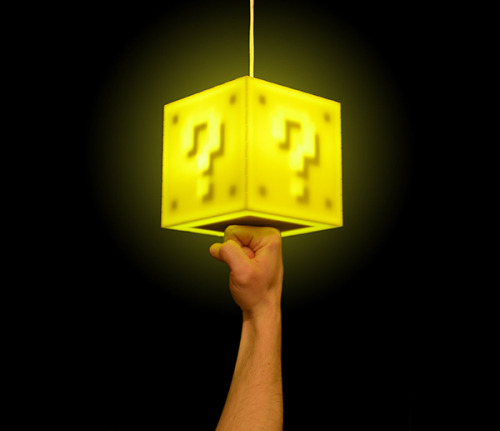 videogamenostalgia:  Super Mario Question Mark Block Lamp Wanna be like Mario? Well, now you can! This question mark block lamp has a touch-sensitive button inside it that allows you to punch it to turn it on and off - just like the famous plumber. It even makes the classic coin sound! You can get it for $75 on Etsy. (via: Technabob)