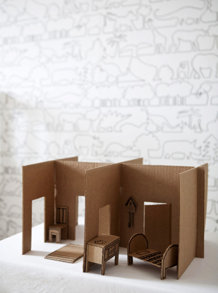 A large cardboard box can easily and ecologically become a recyclable dollhouse. Materials cardboard box (at least 30 x 40 cm large) scissors or a carpet knife hot-melt glue gun or wood glue pencil black marker To do this: 1. Disassemble the box by cutting off the top, bottom, ends and longer sides. 2. Plan the wall sequence with the pieces. Use a pencil to mark where the pieces meet. 3. Cut the doorway holes to the wall pieces. 4. Place the wall pieces crisscrossed and make vertical cuts, where the walls will be against each other. Make a cut from the top to the middle to the first wall and a cut from the bottom to the middle to the other. If the cuts are narrow enough, the walls will stay up even without glue. 5. Use the spare pieces of cardboard to create furniture. 6. Decorate the furniture with a black marker.(Source.)