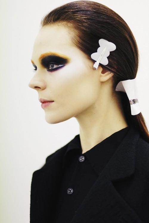 Kinga Rajzak backstage Prada Fall 2012 by Boo George