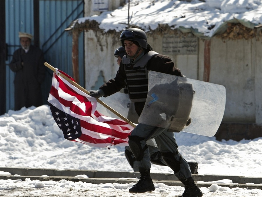 "Bag's Take-Away:  With the Afghan's rioting over the U.S. mission, it's hard not to look at this photo from Kabul this morning, think back on all the chest-beating from the Bush Administration, and recall that Neocon battle phrase: ""These colors don't run.""  via: MSNBC  (photo: Omar Sobhani / Reuters caption: An Afghan policeman runs after confiscating a U.S. flag from protesters in Kabul on Feb. 23, 2012)  Visit BagNewsNotes: Today's Media Images Analyzed  —————  Topping LIFE.com's 2011 Best Photo Blogs — follow us on Twitter and Facebook."