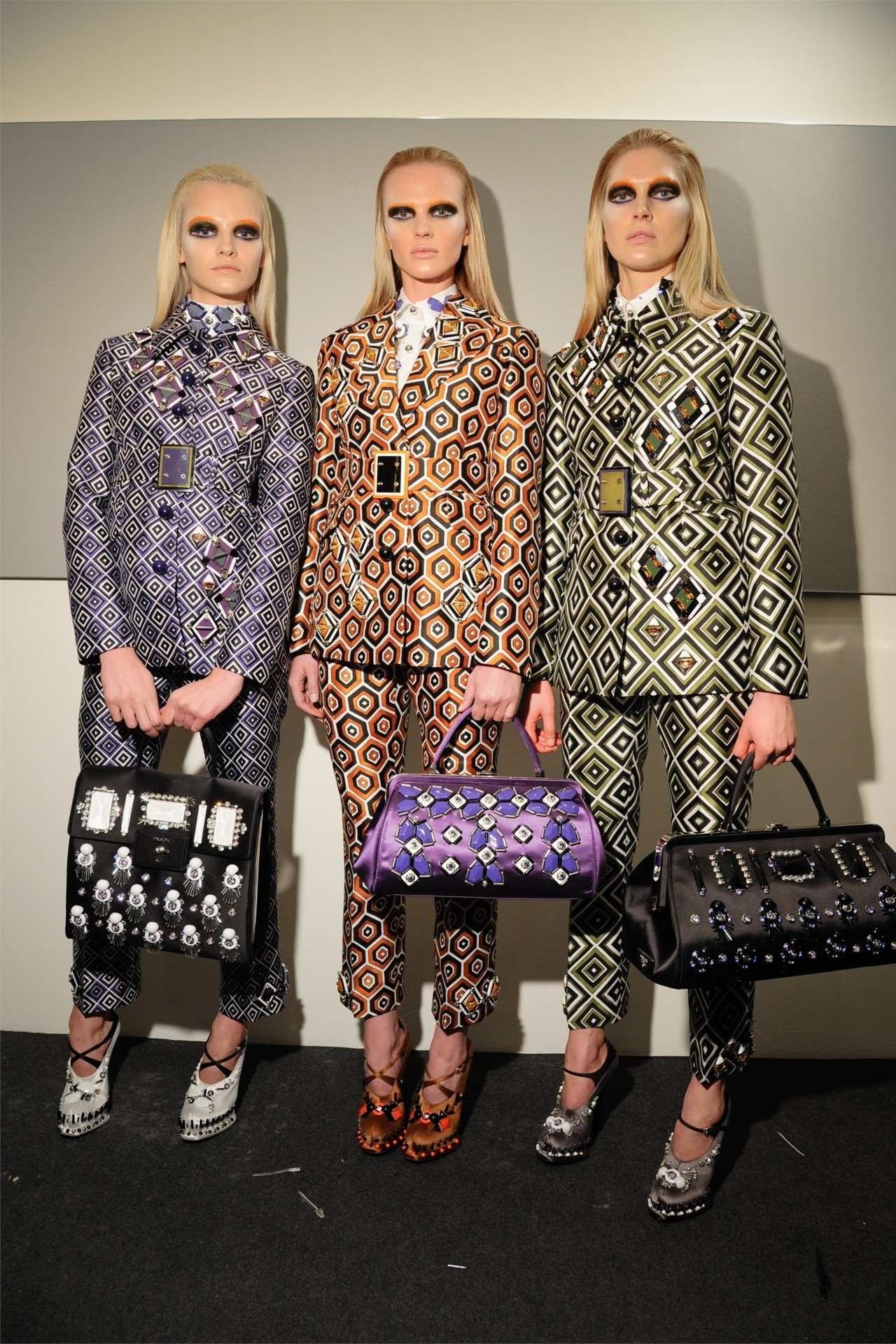 Ginta Lapina, Anne V and Iselin Steiro backstage at Prada fw12.