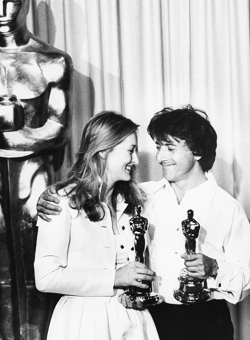 Meryl Streep and Dustin Hoffman posing with their Oscar awards as they stand next to large Oscar statue during the 53rd Annual Academy Awards, 1980.