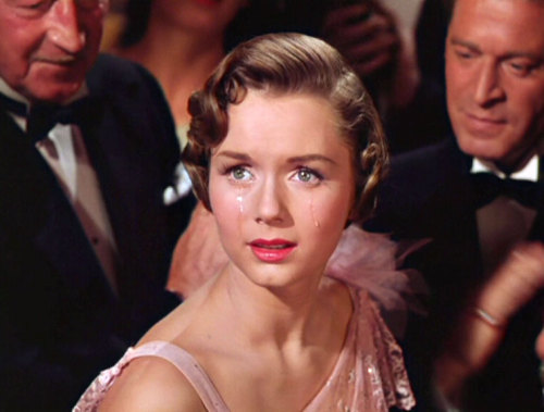 "Singin' In The Rain ""Only 19 when cast to play the film, Debbie Reynolds lived with her parents and commuted to the set. She had to wake up at 4:00 a.m. and ride three different buses to the studio; sometimes, to avoid the commute, she would just sleep on the set."""