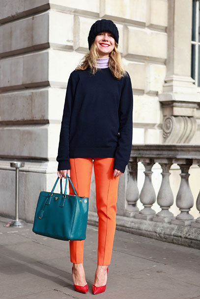 A great example of color-blocking. Teal, lavender, navy, orange, and red! I've been seeing a lot of bright oranges and soft lavenders for spring - two colors that are beautiful but not always easy to wear. The ample use of navy, a hue that anyone can pull off and that never goes out of fashion, helps temper the harder-to-wear colors.
