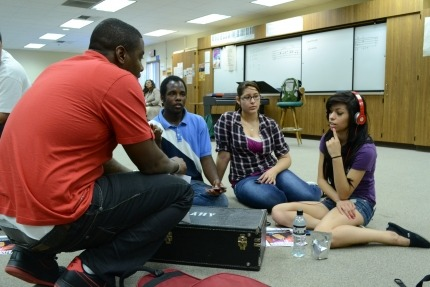 Josiah working with students at Music Changing Lives