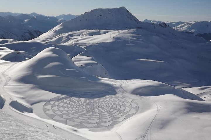 Man Walks All Day to Create Spectacular Snow Patterns   Artist Simon Beck must really love the cold weather! Along the frozen lakes of Savoie, France, he spends days plodding through the snow in raquettes (snowshoes), creating these sensational patterns of snow art. Working for 5-9 hours a day, each final piece is typically the size of three soccer fields! The geometric forms range in mathematical patterns and shapes that create stunning, sometimes 3D, designs when viewed from higher levels.  How long these magnificent geometric forms survive is completely dependent on the weather. Beck designs and redesigns the patterns as new snow falls, sometimes unable to finish a piece due to significant overnight accumulations. Interestingly enough, he said, 'The main reason for making them was because I can no longer run properly due to problems with my feet, so plodding about on level snow is the least painful way of getting exercise.