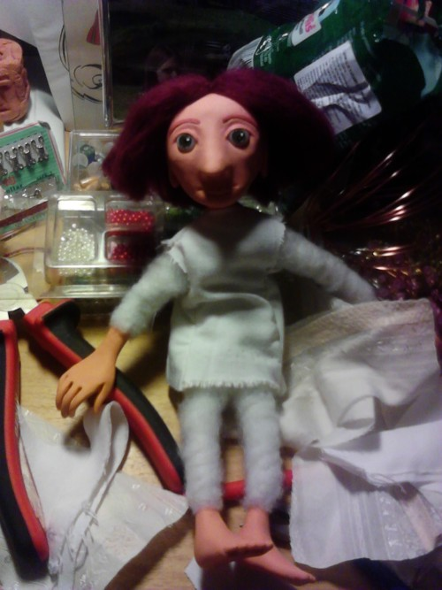 One of my newest polymer clay dolls on my incredibly messy desk. This just a sneak peek, so please excuse the rather horrible photo quality. His clothes aren't finished and actually I have quite a few older dolls to post before him, but I thought I'd share a first glimpse of him nonetheless. If you're interested in my adventures in doll-making field, you can also visit my blog for more details. :)