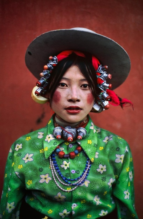 Woman at a horse festival, Tagong, Tibet, 1999 by Steve McCurry
