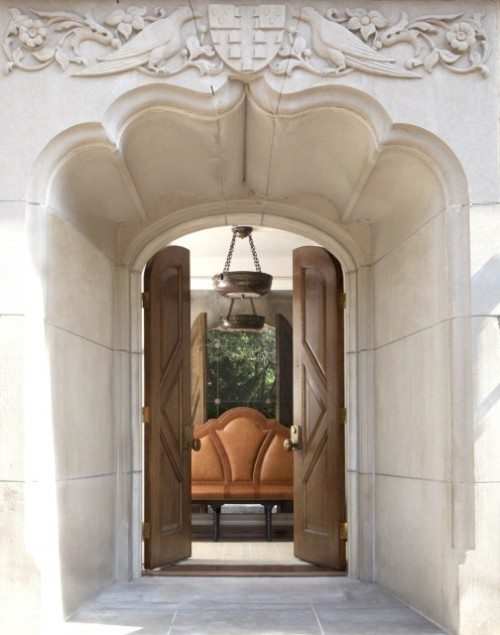 Tons of carved marble and double wood doors create an extremely impressive entryway (via Cotswolds Manor - by Burns and Beyerl Architects)