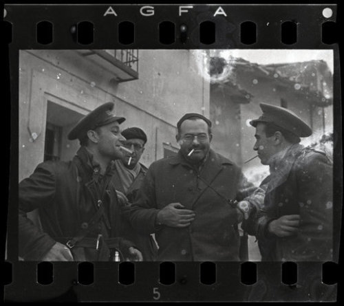"thediaryofadisappointingman:  Ernest Hemingway on the front line with The International Brigades, who were made up of volunteers from 53 different countries who chose to travel to Spain and fight against Franco's fascist army during the Spanish Civil War. Robert Capa - Teruel, Spain, December 1937. (Negative from Capa's ""Mexican Suitcase,"" lost after World War II then rediscovered in 2007.)"